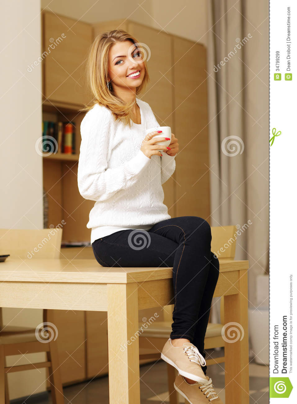 Woman Sitting On The Table And Drinking Coffee Royalty  : woman sitting table drinking coffee casual young 34799299 from dreamstime.com size 957 x 1300 jpeg 115kB