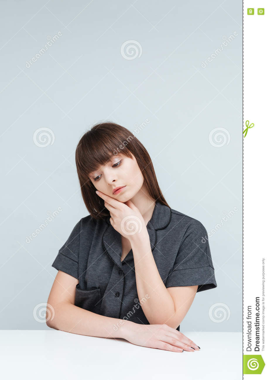 Royalty Free Stock Photo. Download Woman Sitting At The Table ...