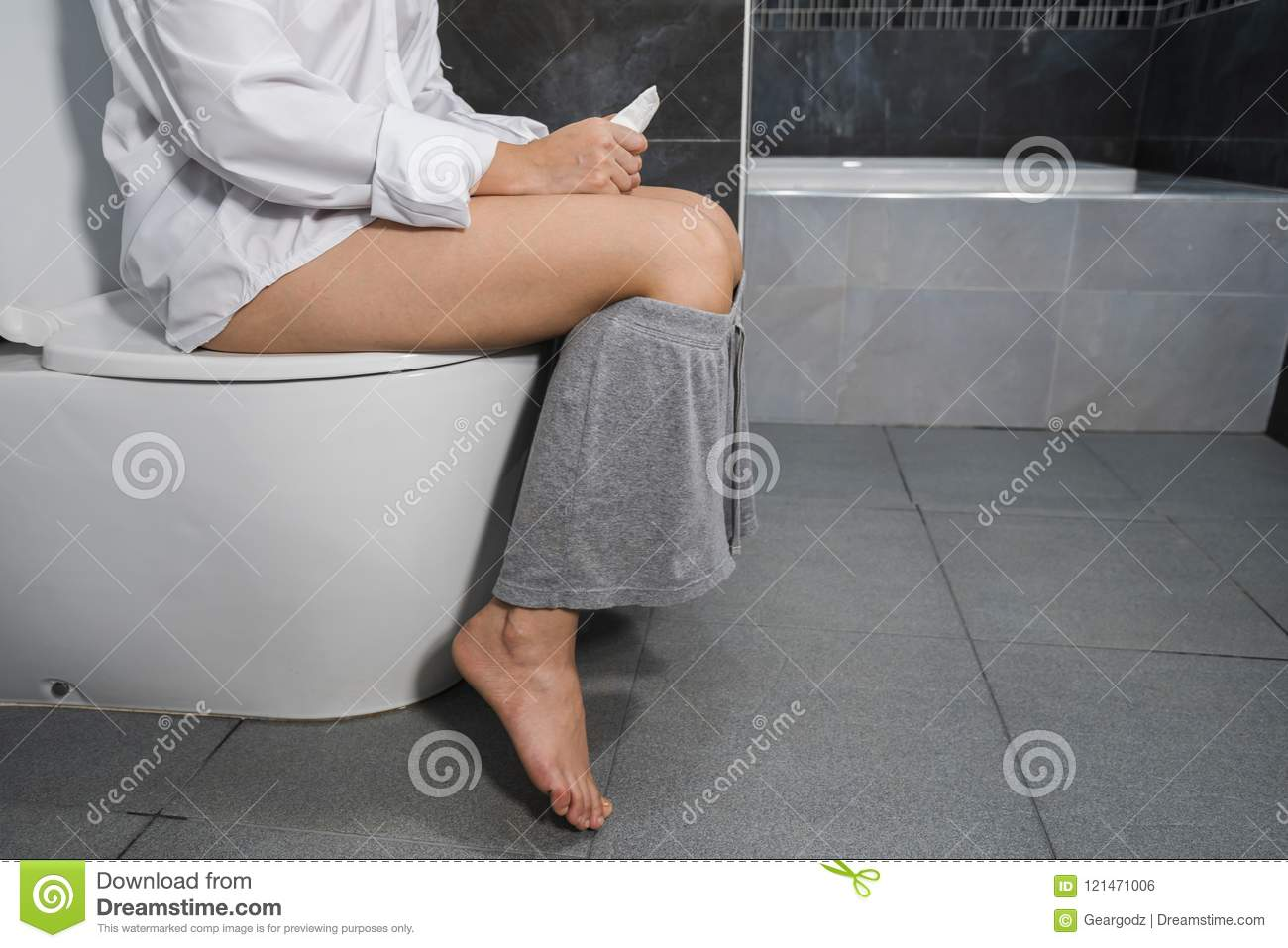 Young Woman Sitting On Toilet Stock Footage Video (100%