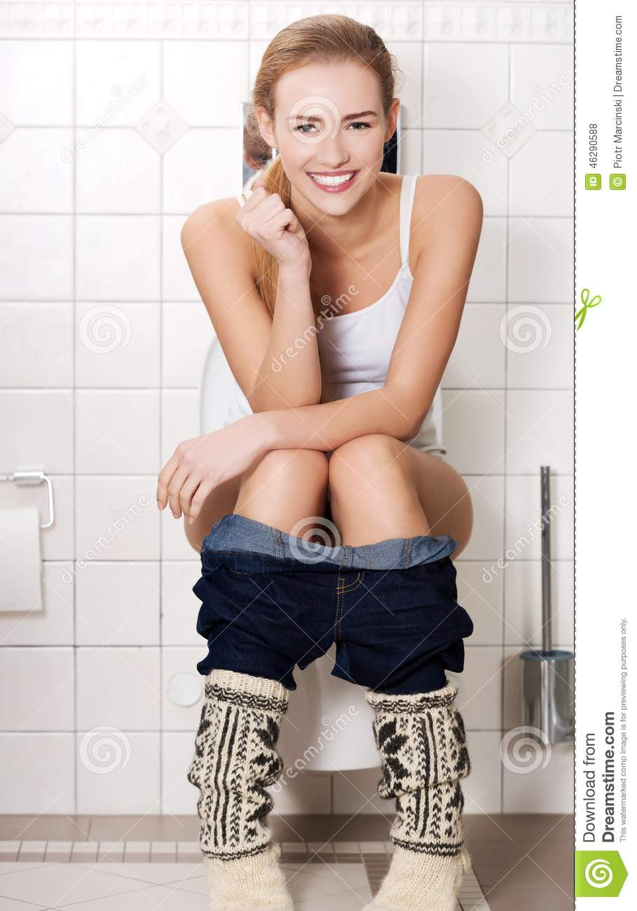Woman using a smartphone on toilet in morning. — Stock