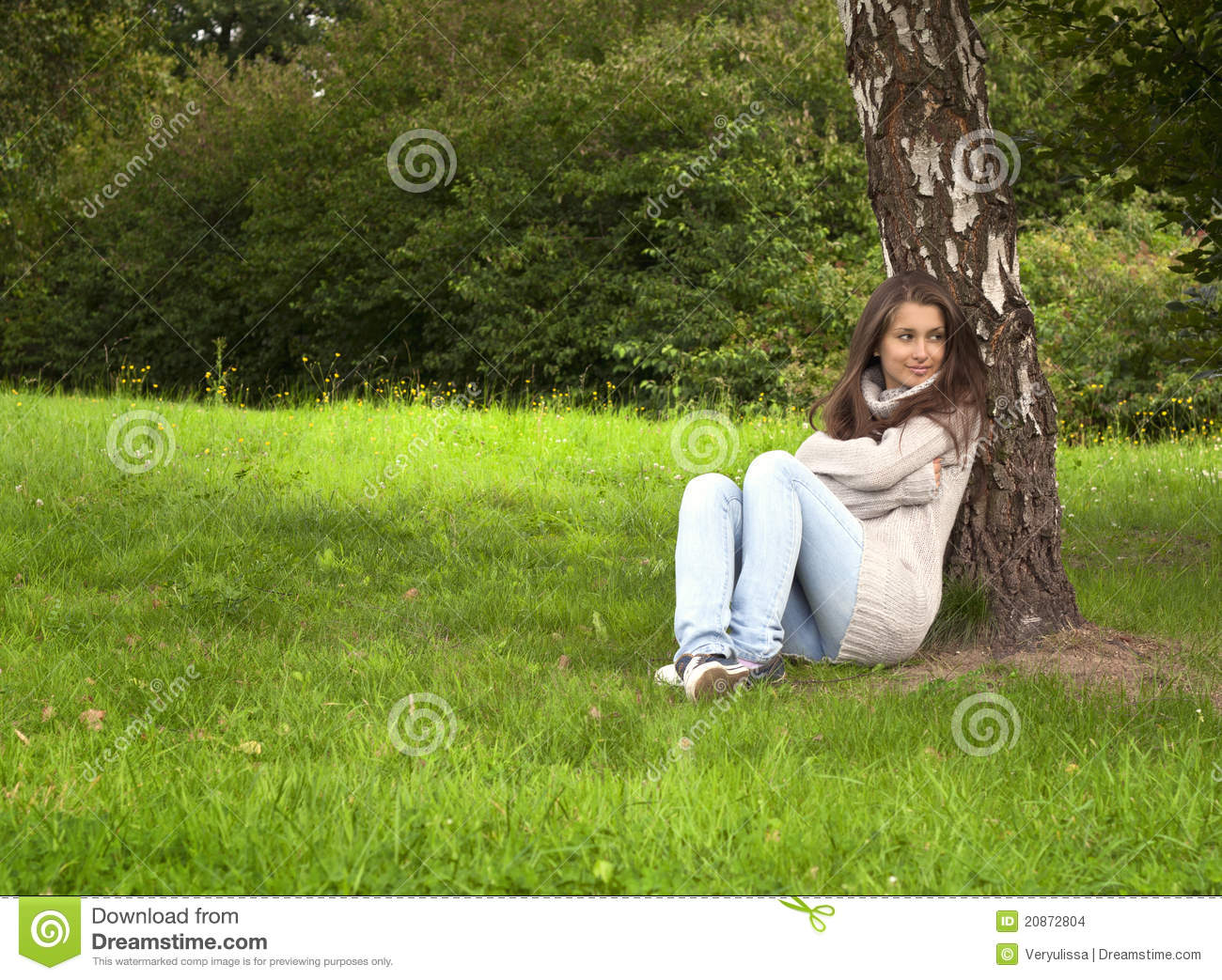 Small Girl Sitting Under The Cherry Tree Stock Photo - Image: 44704997