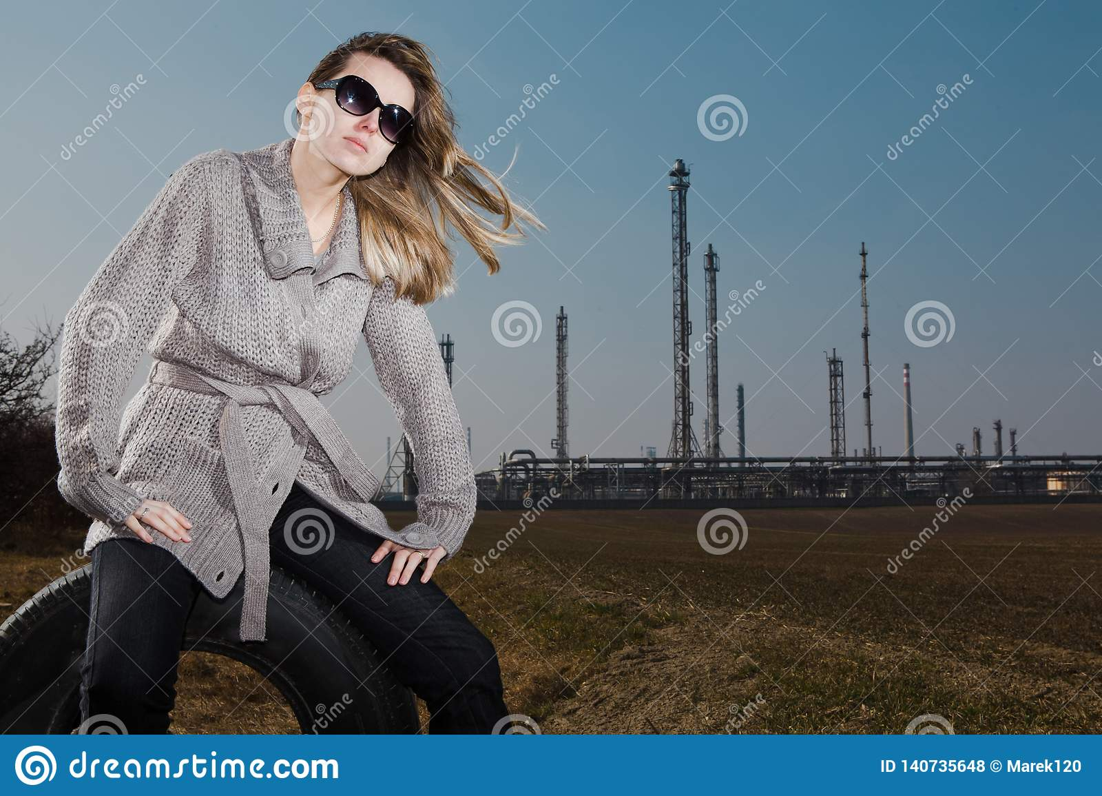 Woman sitting on used tire - Natural skin with no retouches