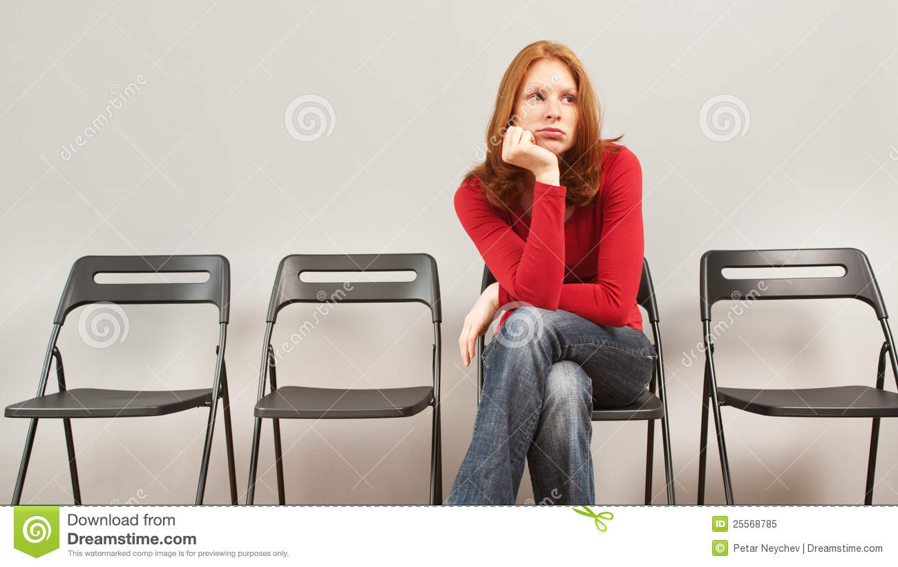 The young woman is sitting bored at a table — Stock Photo ...