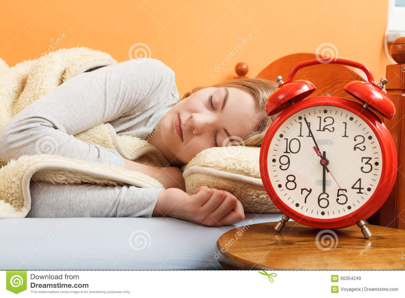 Woman Sleeping In Bed With Set Alarm Clock  Stock Image - Image of