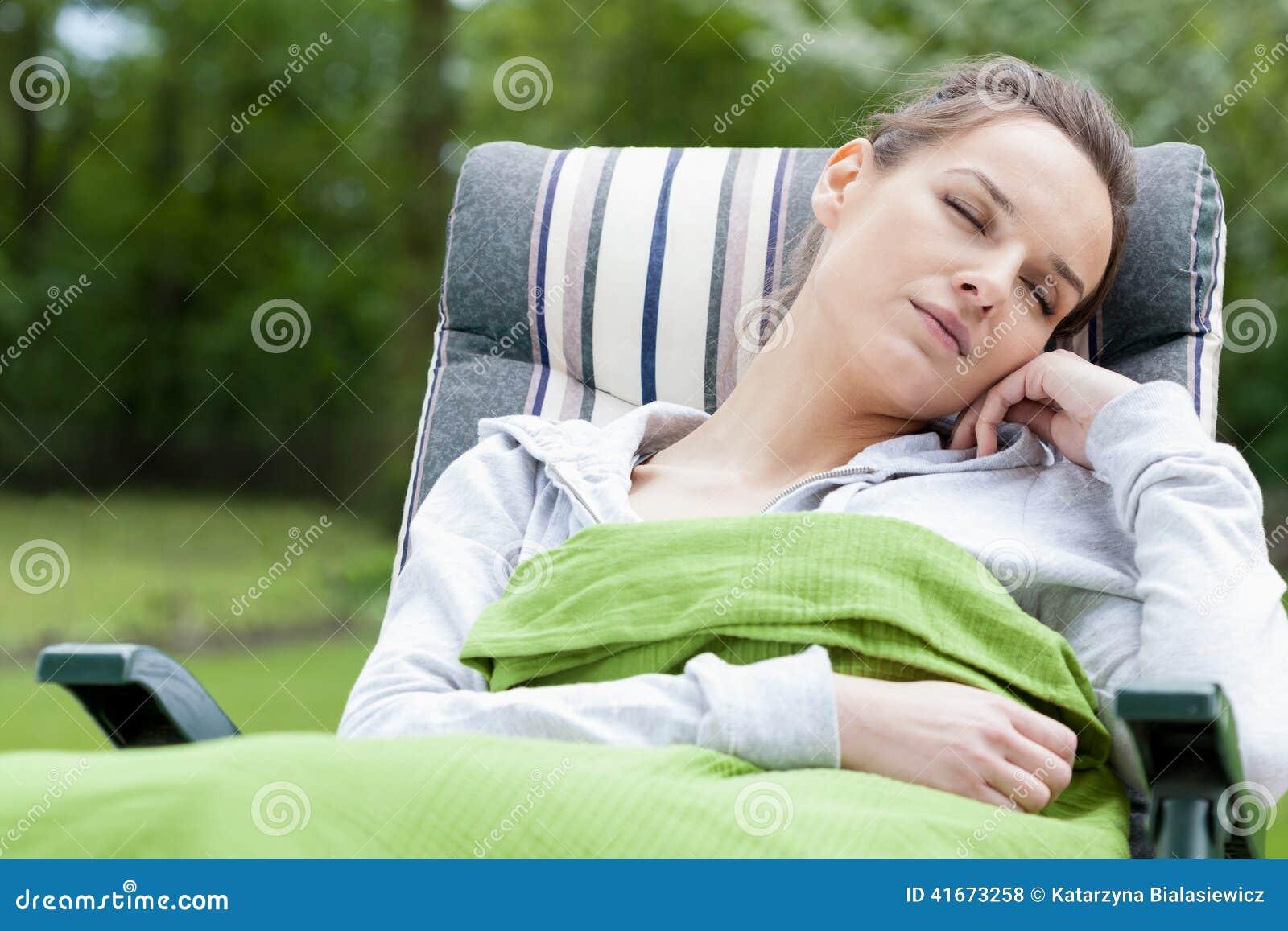 Woman sleeping in a garden