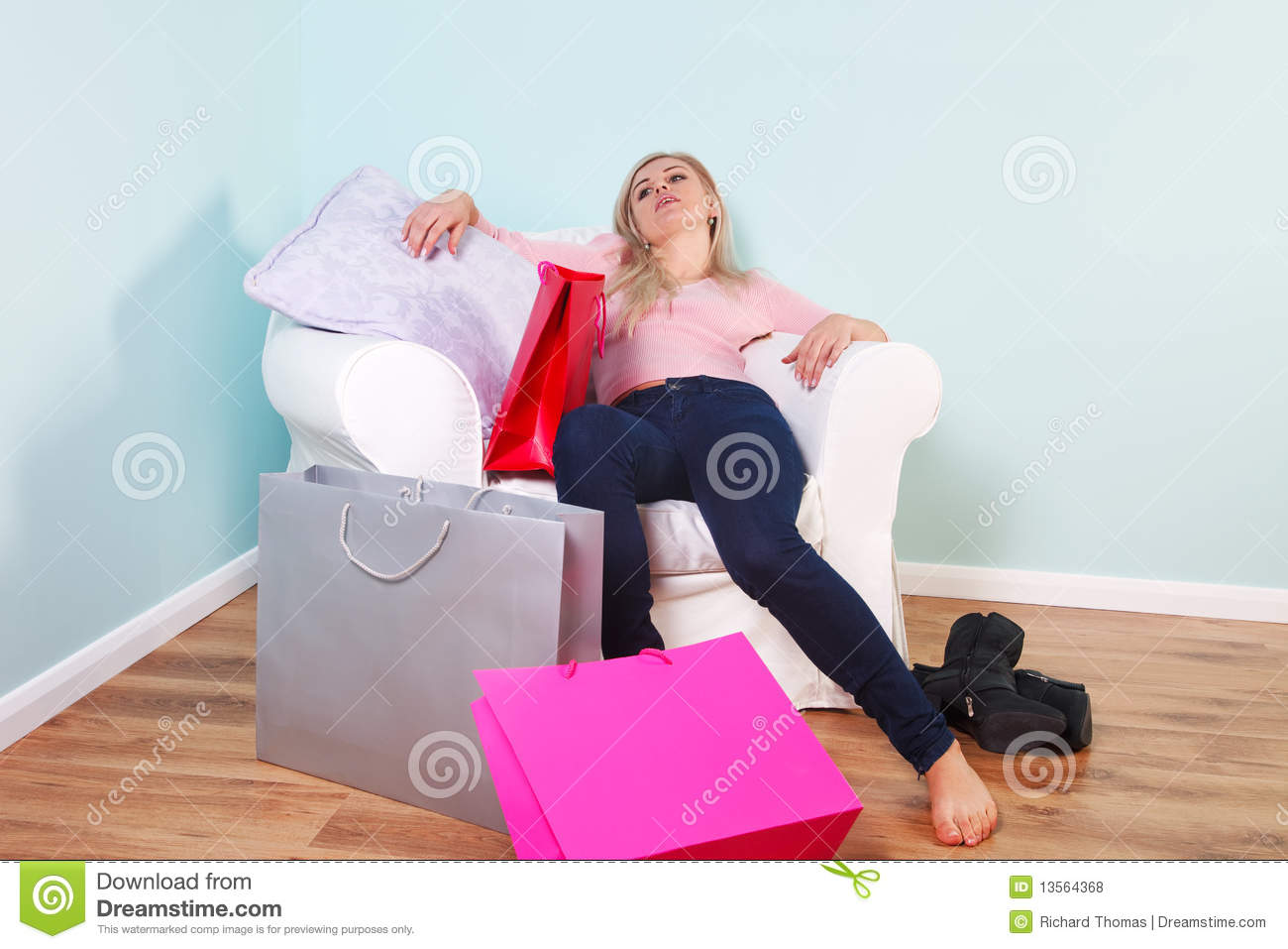Woman Slumped In An Armchair After Shopping Trip Royalty