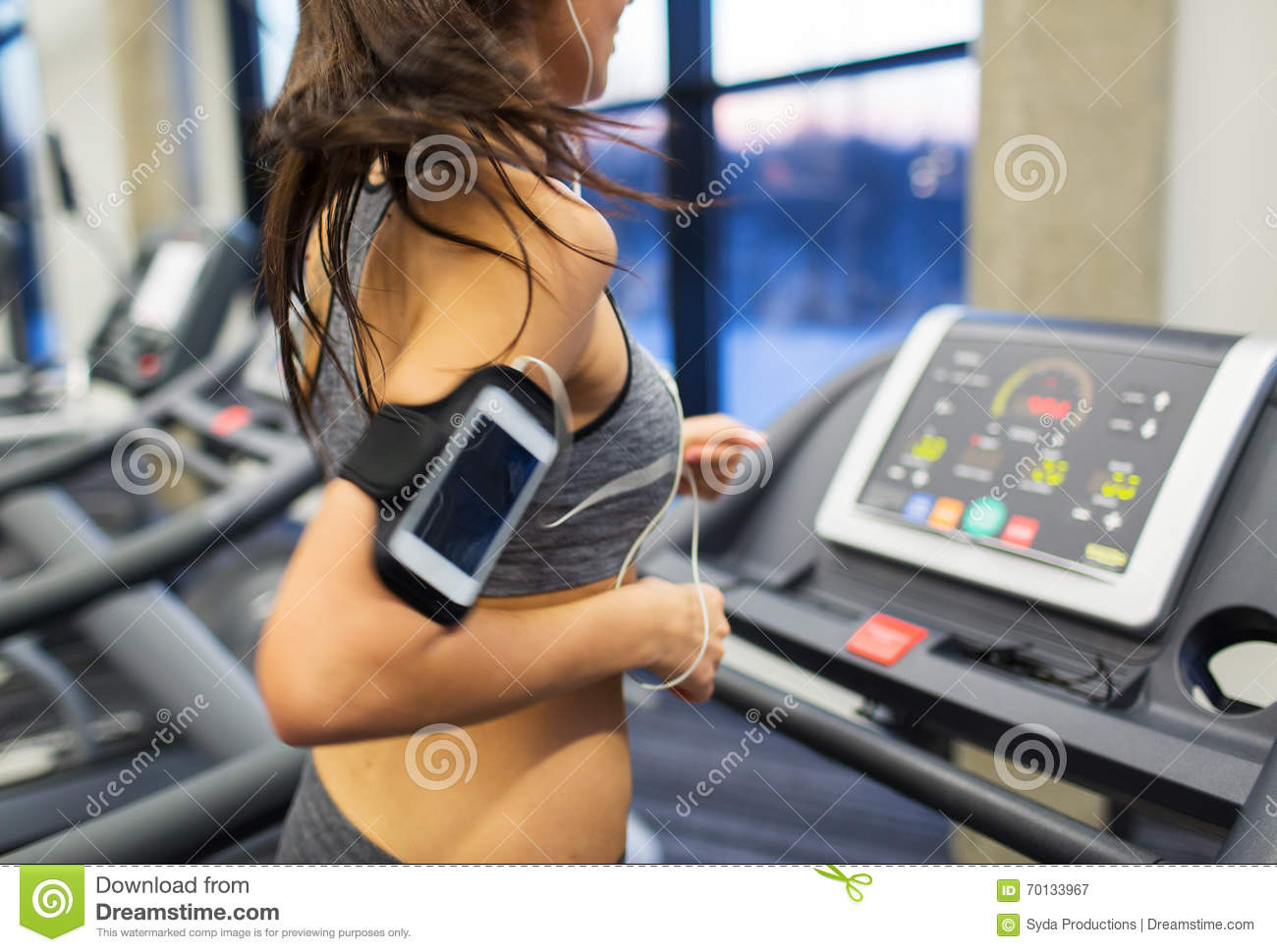Woman With Smartphone And Earphones In Gym Stock Image ...