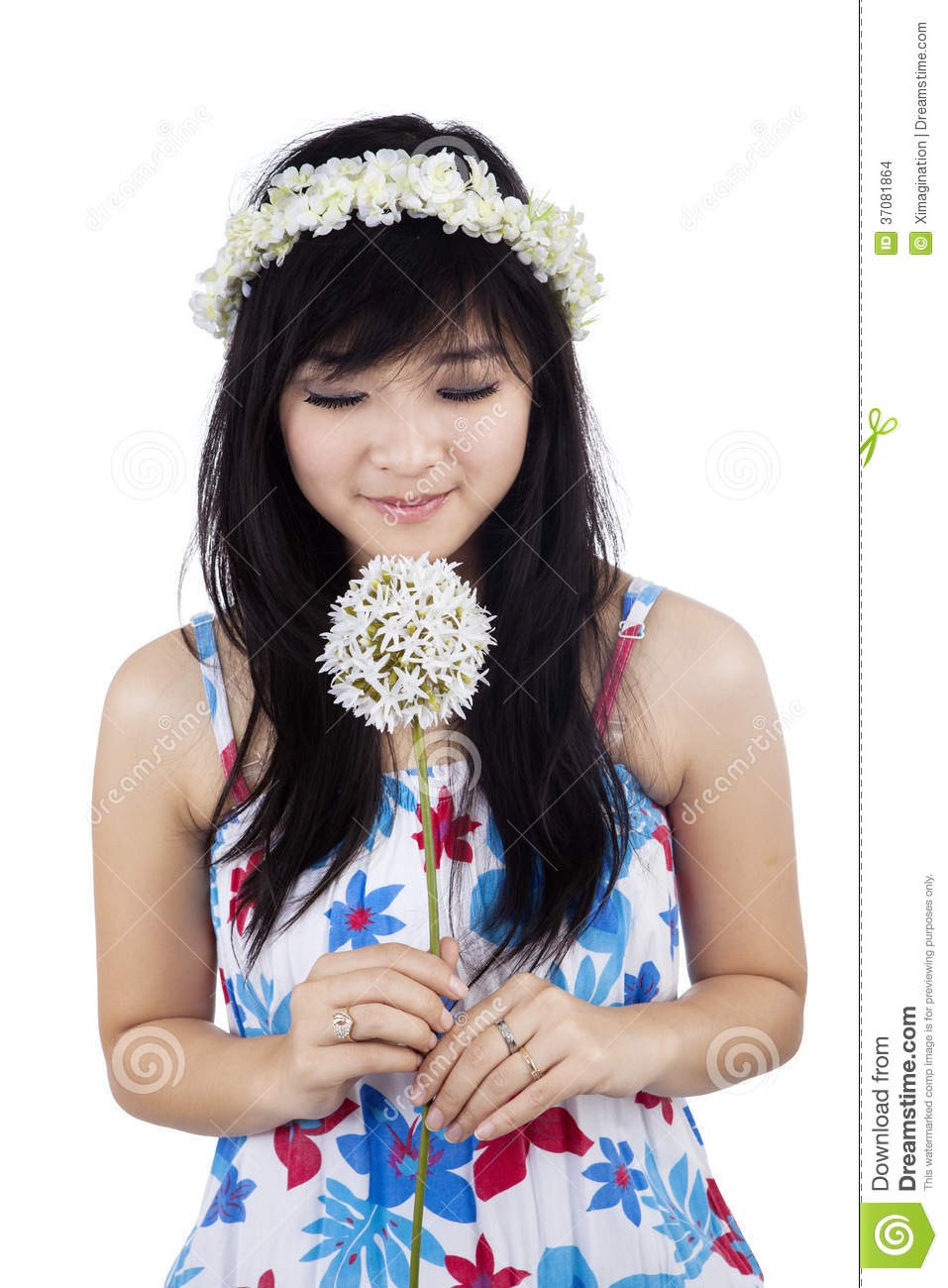A woman smelling flower