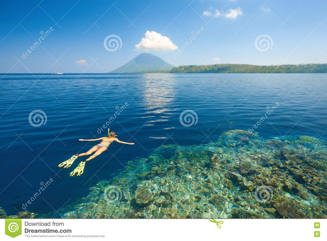 Download Woman Snorkeling In Clear Tropical Waters On A Background Of Isl Stock Image - Image of female, blue: 74183627