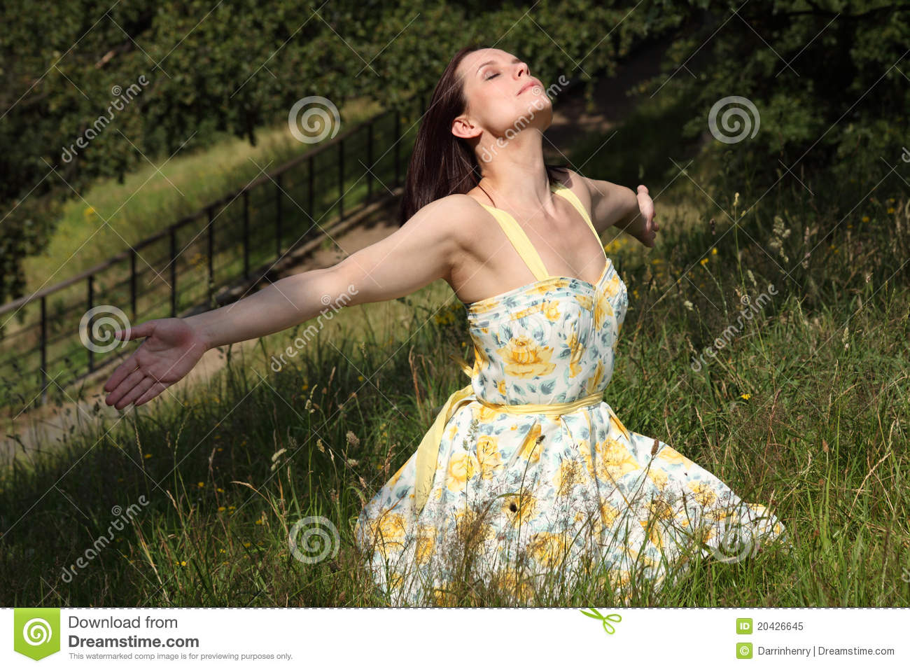 Woman soaking up summer sun in countryside