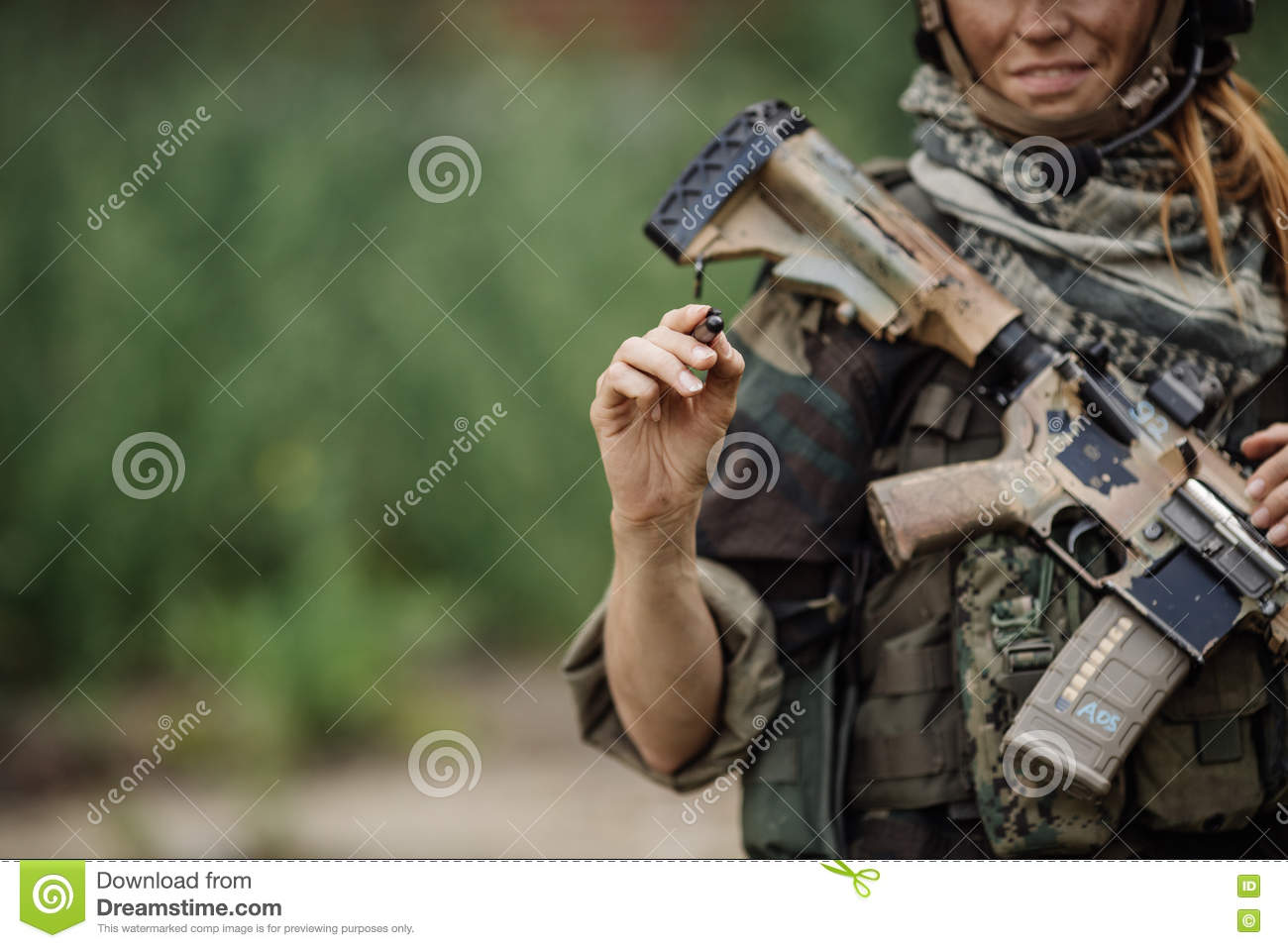 Woman soldier writes marker