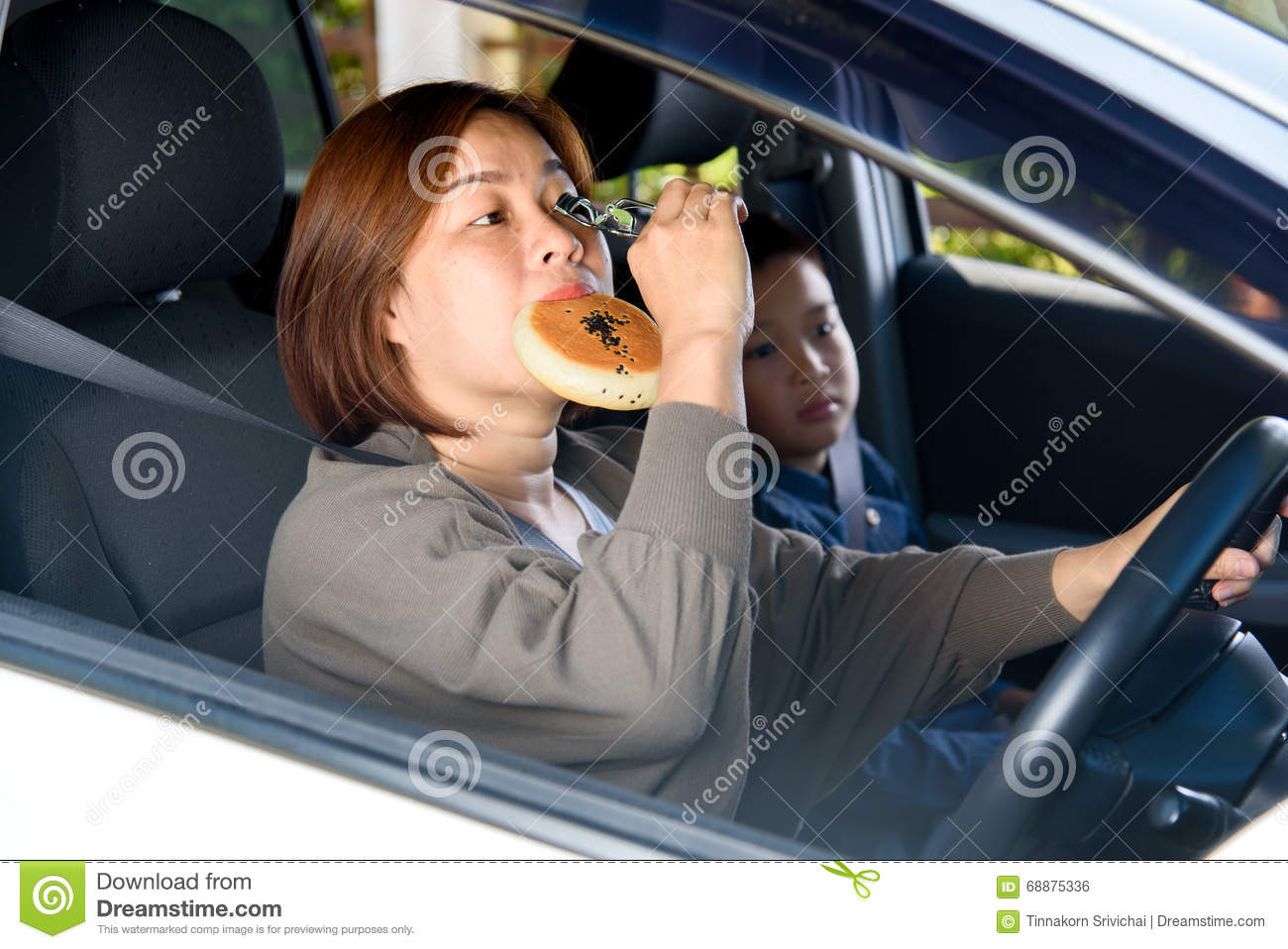 Woman and son in car