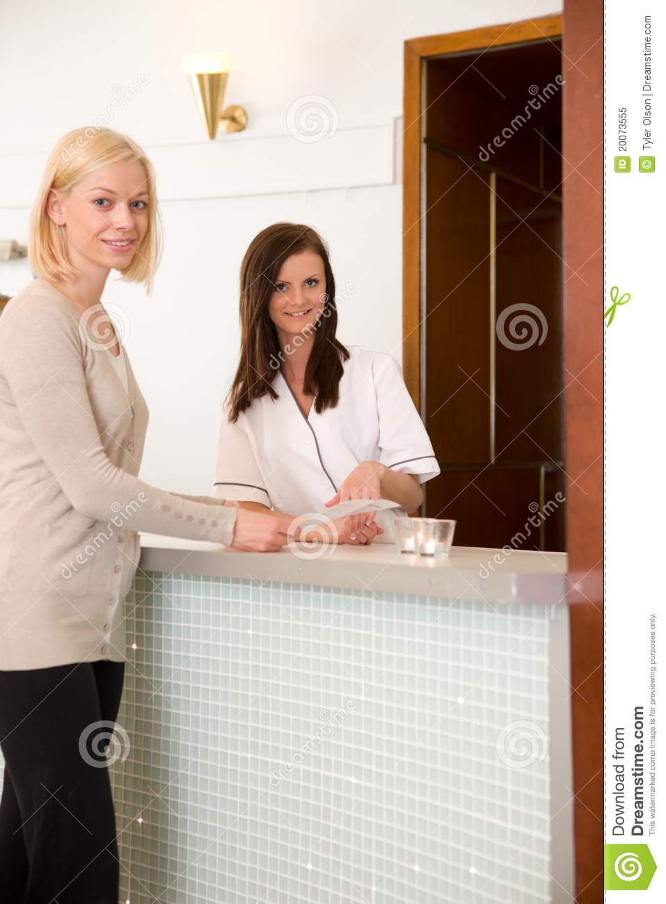 woman in spa reception royalty free stock photo