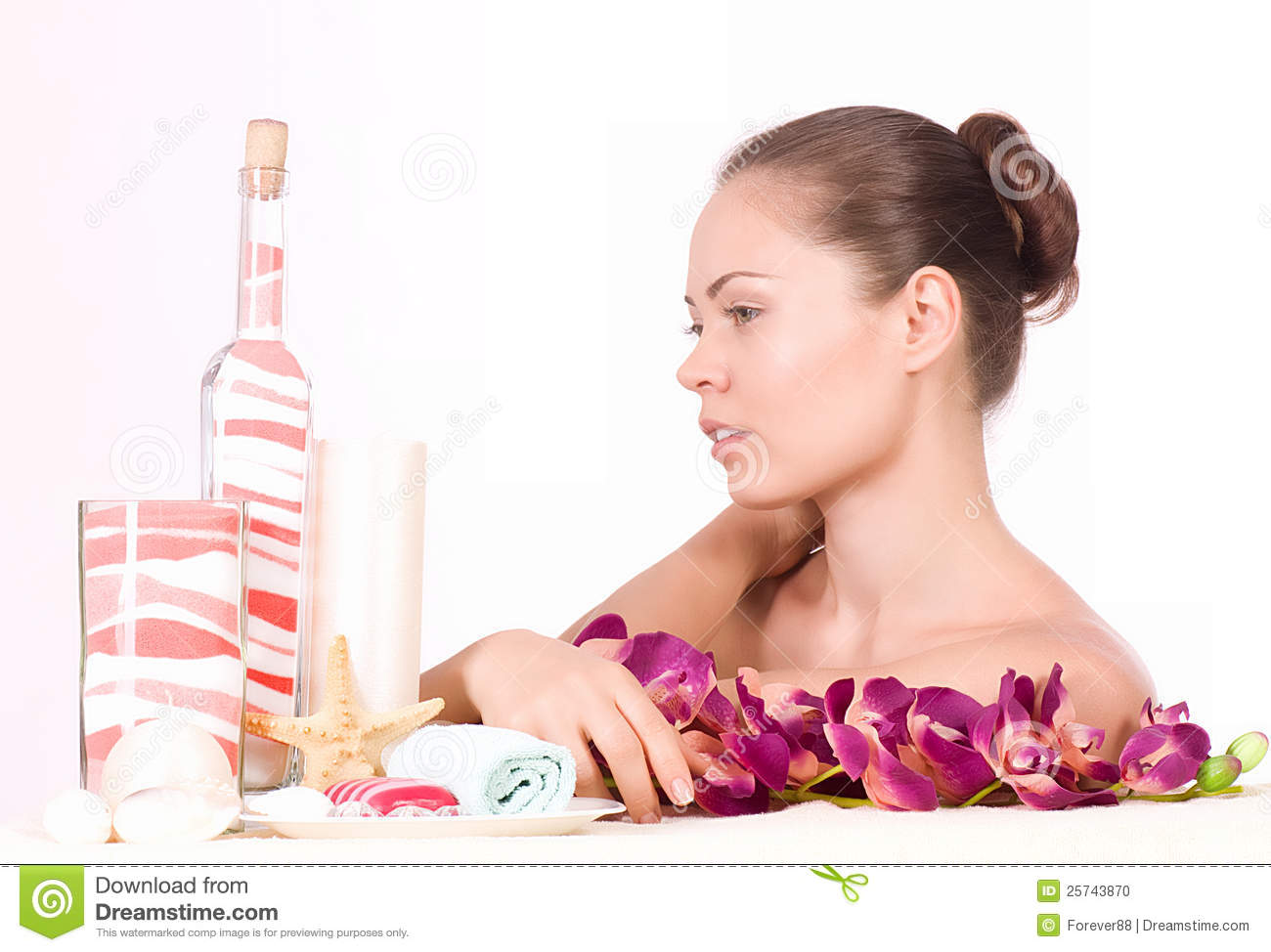 Woman with spa salts and orchid