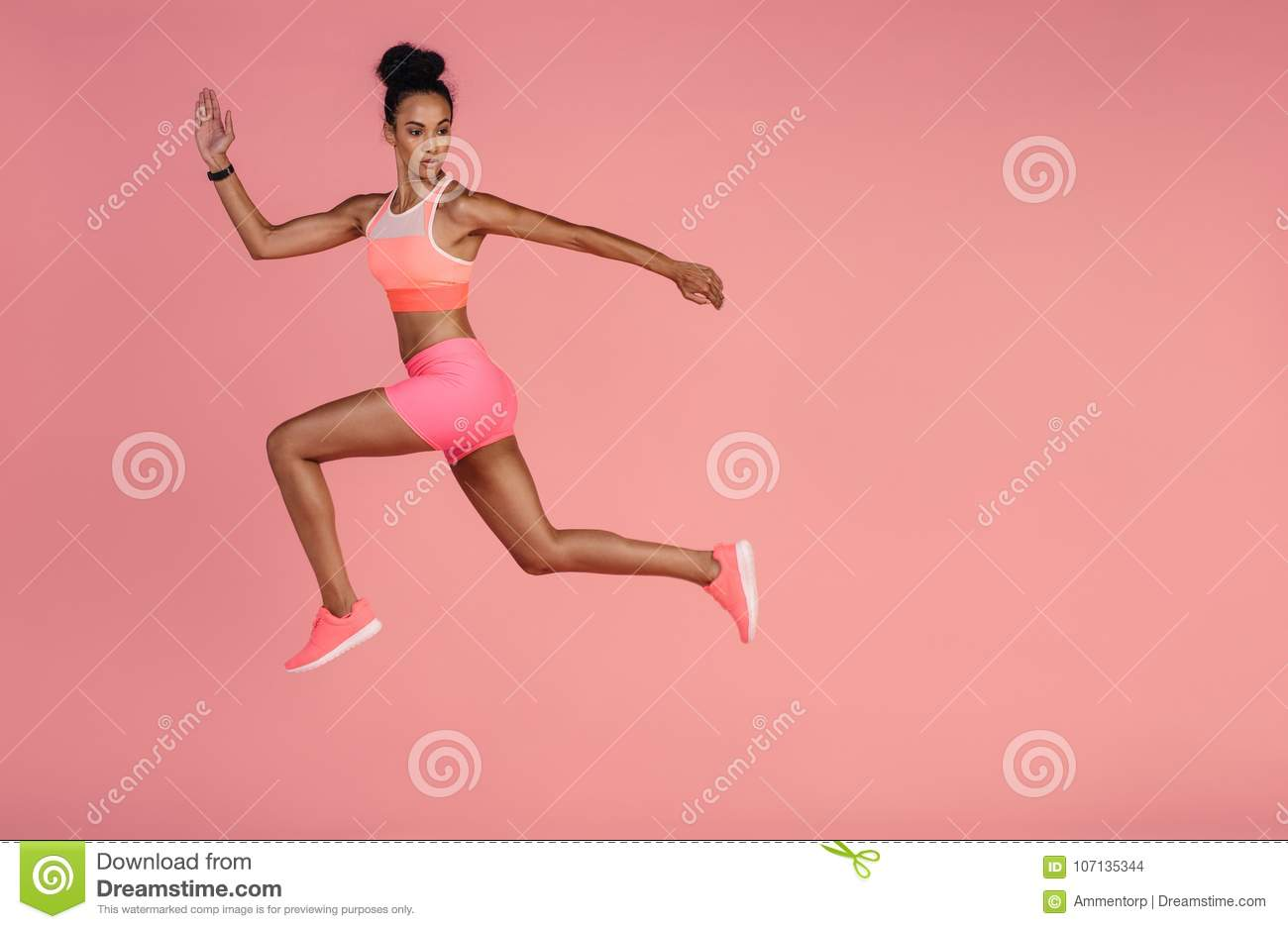 Download Healthy African Woman Sprinting On Pink Background Stock Photo - Image of jumping, lunge: 107135344