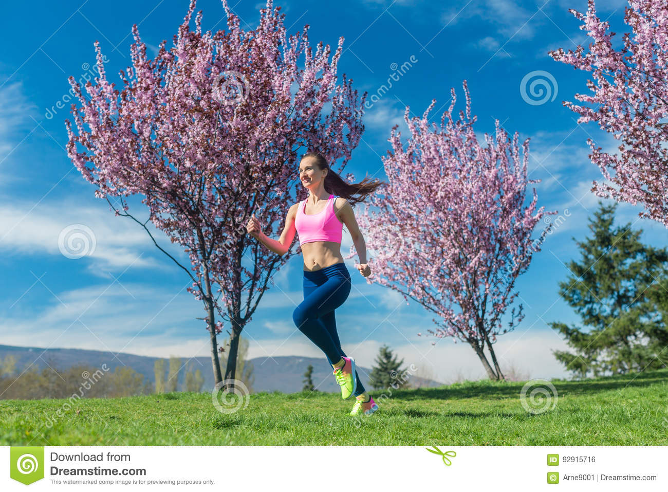 Woman in spring running or jogging as sport