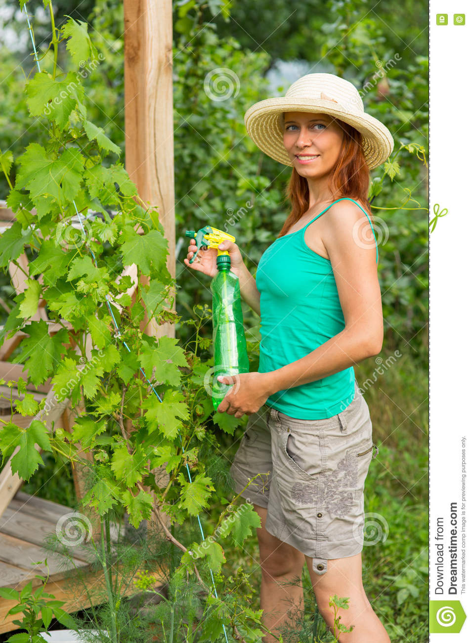 Woman squirting grapes solution