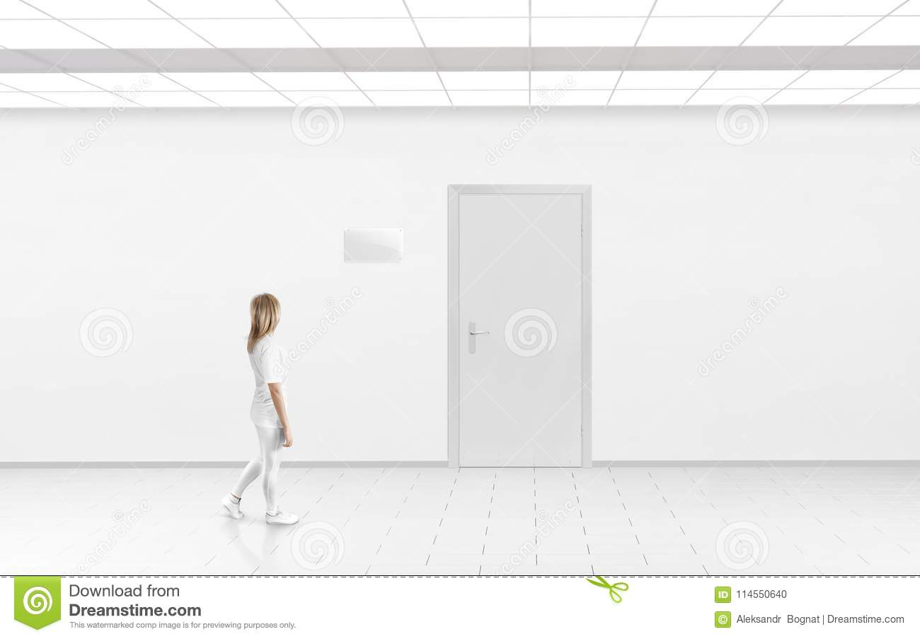 Woman Stand Near Door With Blank Glass Name Plate Mockup Stock