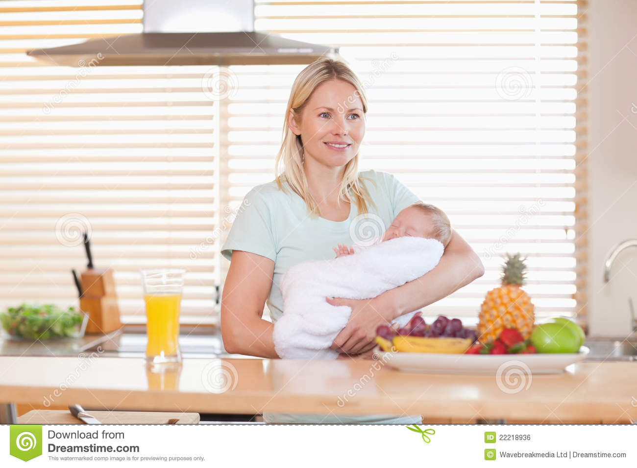 Woman Standing In The Kitchen Holding Her Baby Royalty Free Stock ...