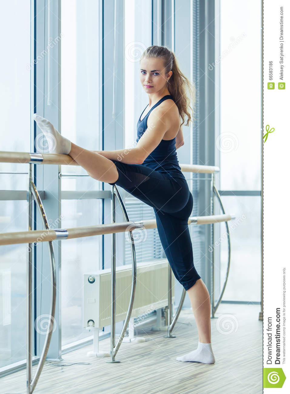 woman standing near barre in fitness center stock photo image 66583186. Black Bedroom Furniture Sets. Home Design Ideas
