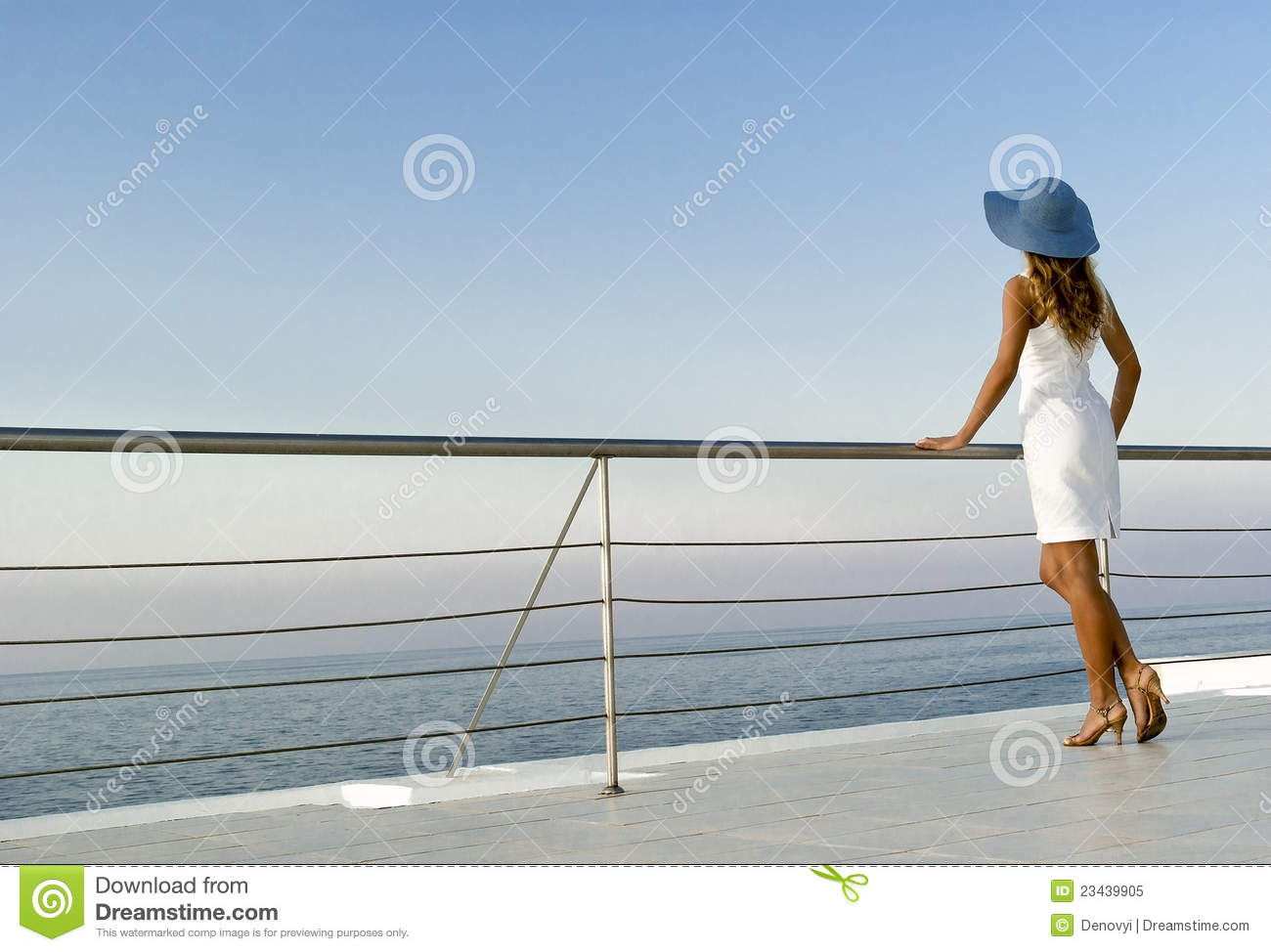 Woman standing near railings and looking far