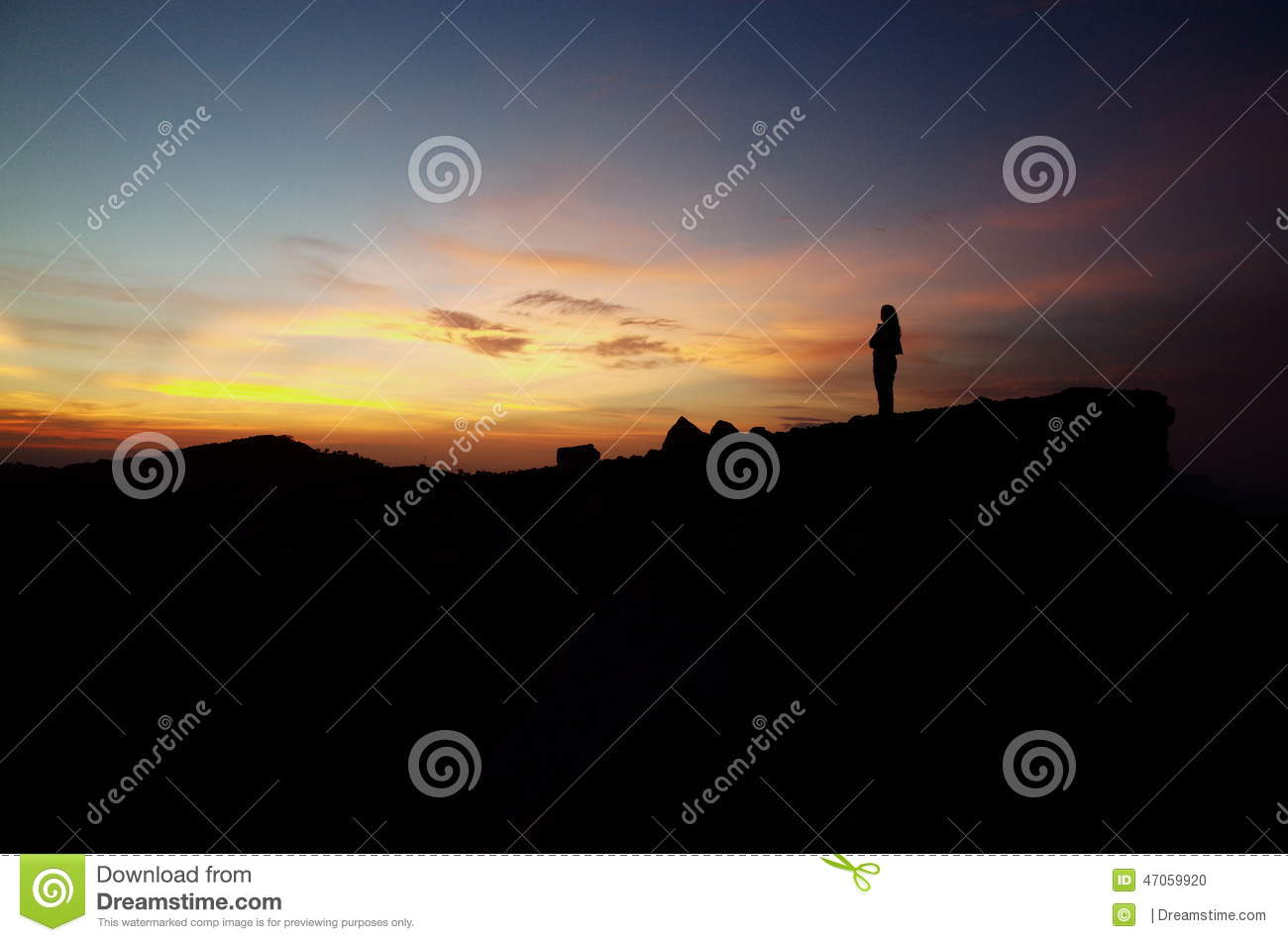 Woman standing at the top of a volcano