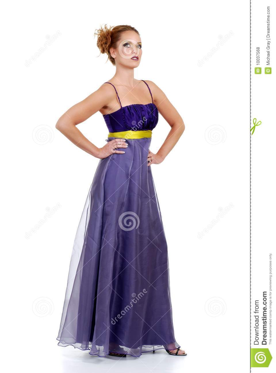 Woman Standing Wearing A Purple Lace Dress Royalty Free