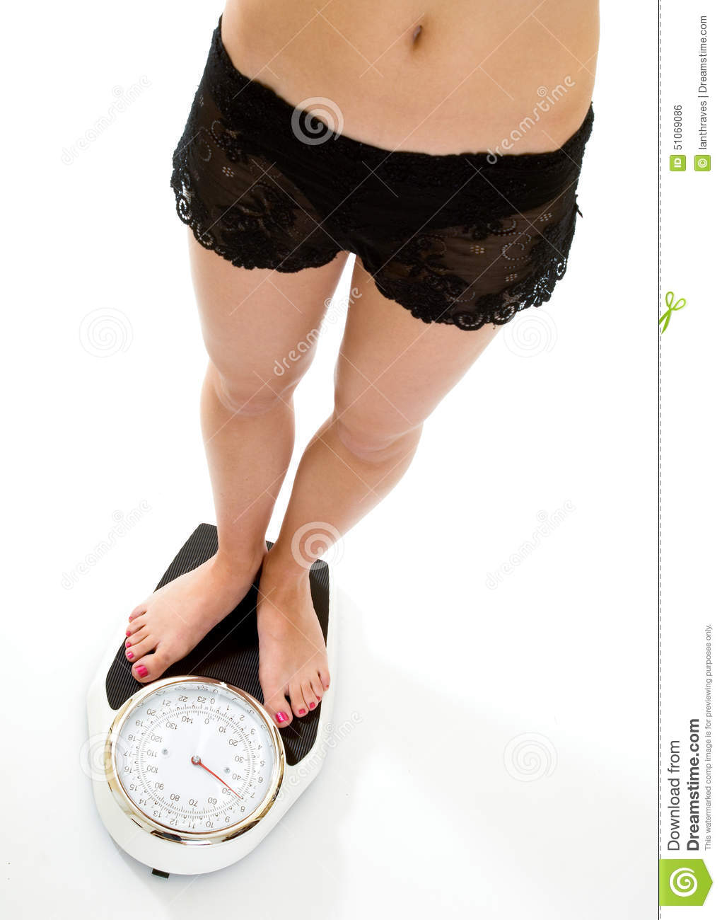 Woman Standing On Weighing Scales On Wooden Floor Low