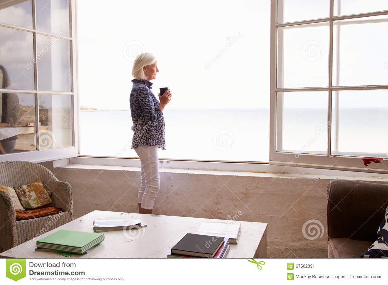 Woman Standing At Window And Looking At Beautiful Beach View