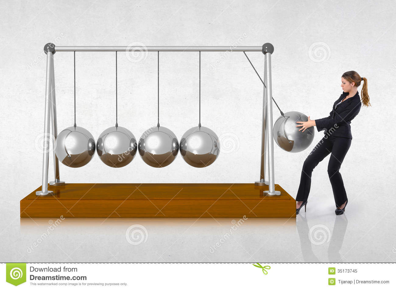 Woman Starting A Perpetual Motion Royalty Free Stock Photo - Image ...