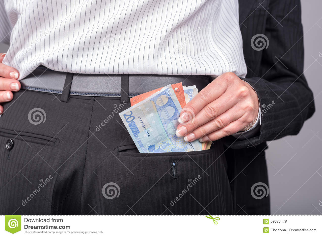 Woman Stealing Money In The Pocket Of Her Lover Stock ...