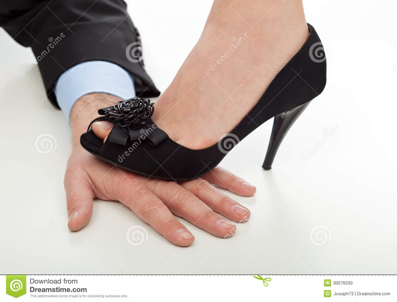 Woman Stepping On Man Woman step on the hand Stock