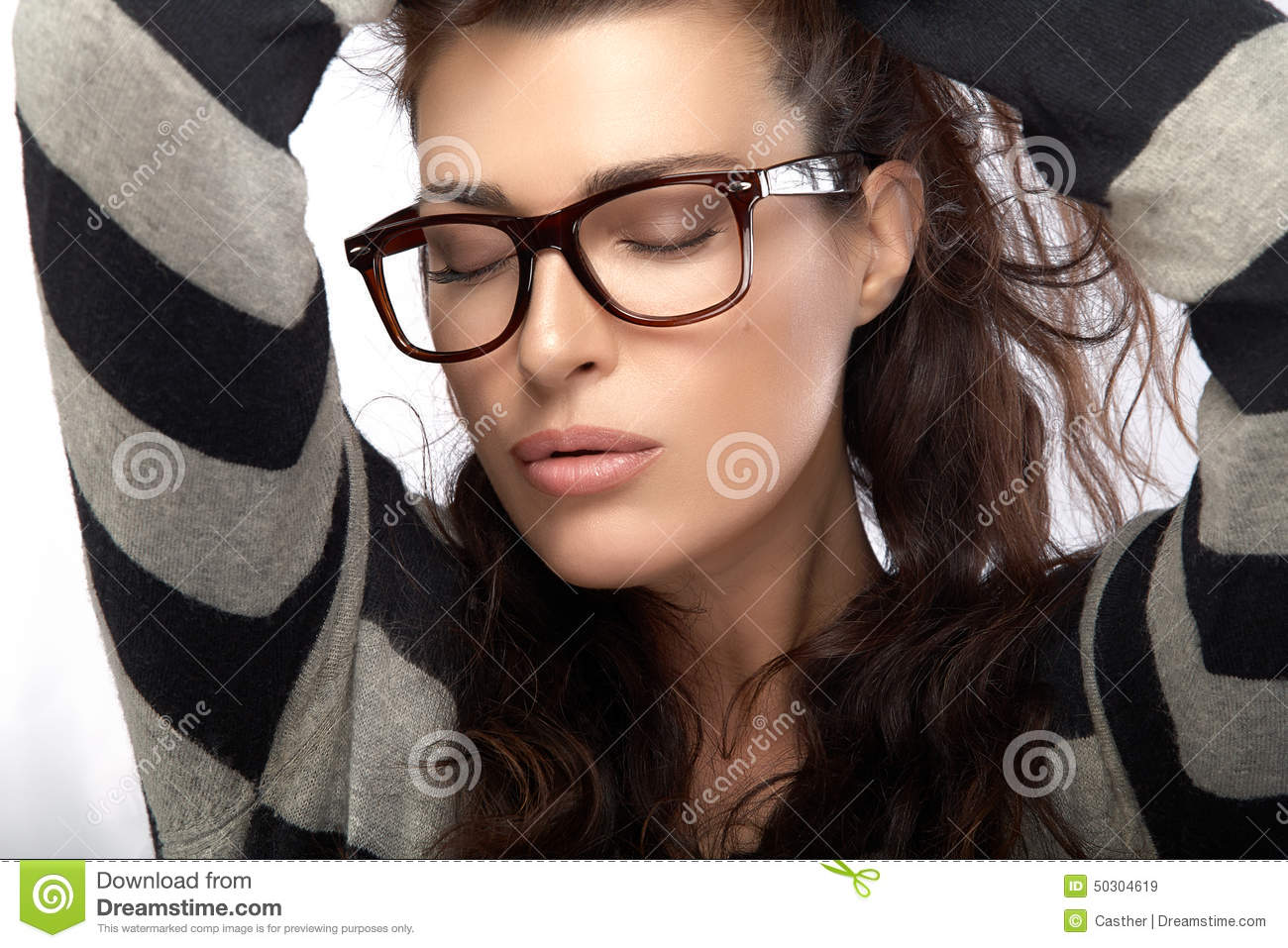 trendy eyewear hufo  Woman in Striped Jersey Holding her Hair Cool Trendy Eyewear Royalty Free  Stock Images