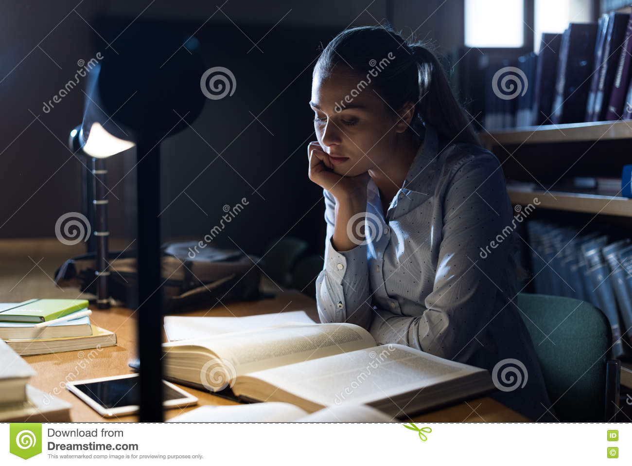 Woman studying late at night