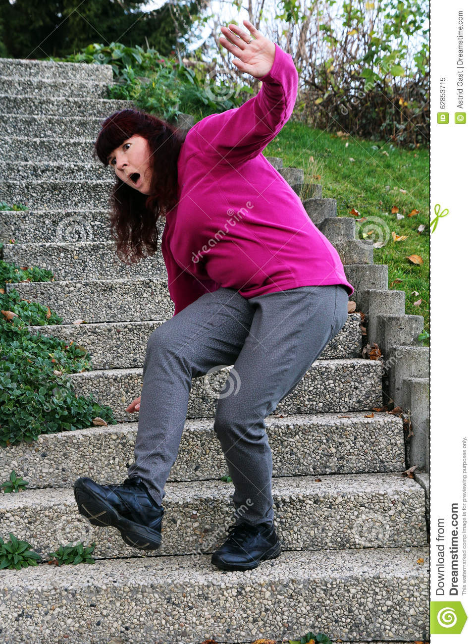 A Woman Stumbles On A Staircase Stock Image - Image of injury