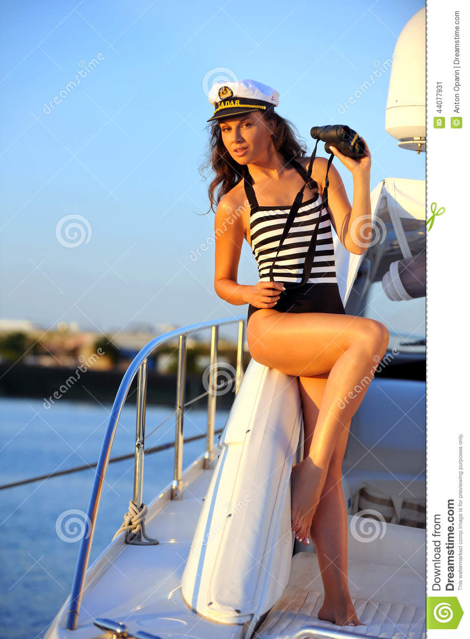 Woman In Stylish Swimsuit And Captain Hat On Private Speed ...