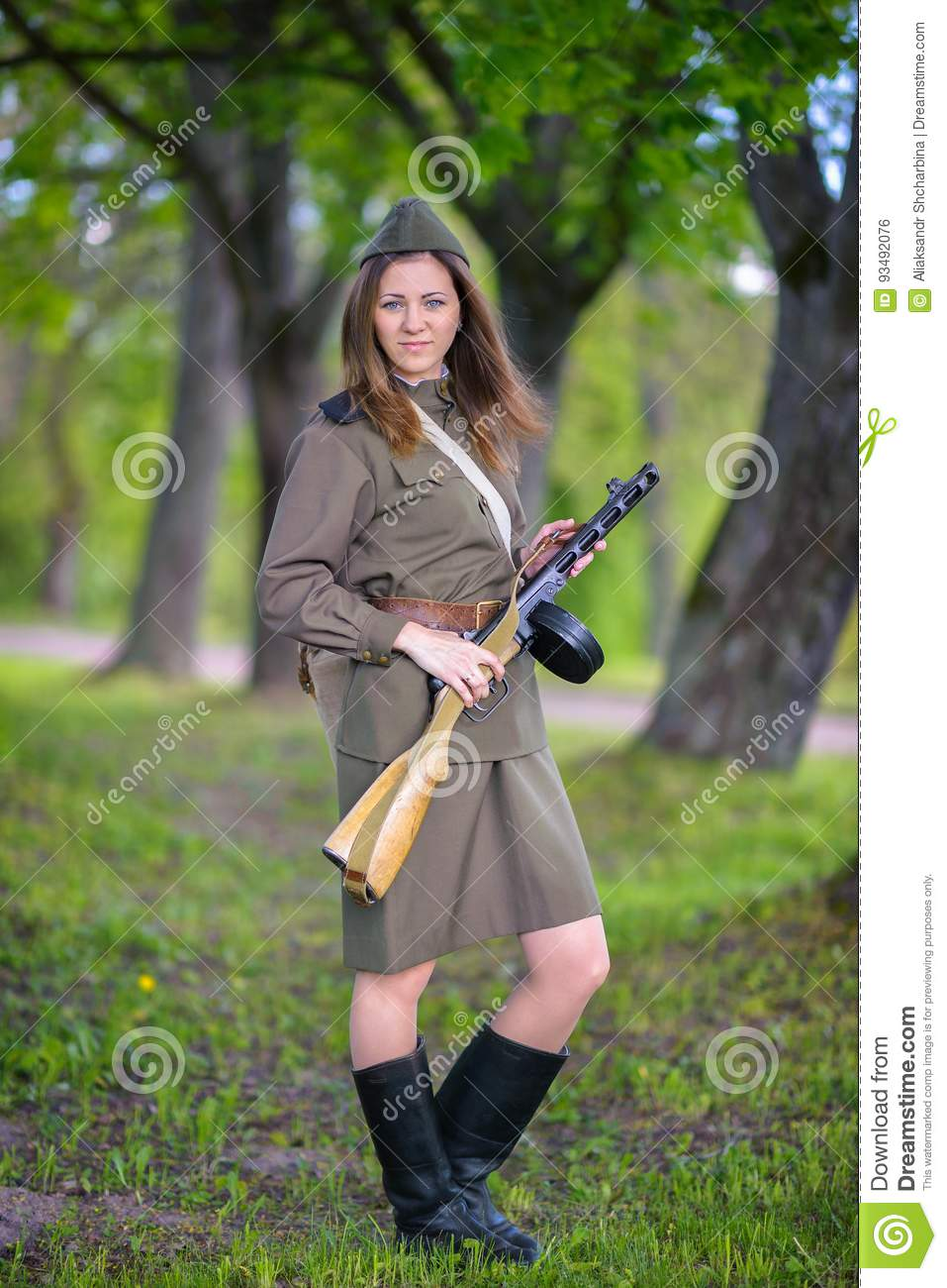Woman in a submachine gun in hands