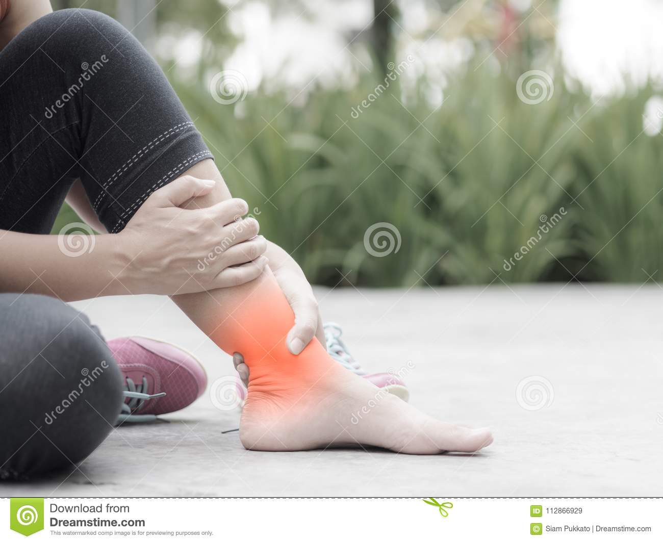 ed8822b0c4 Woman Suffering From An Ankle Injury While Exercising. Stock Image ...