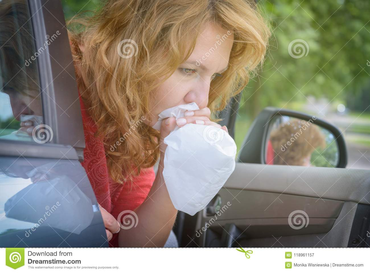 Woman suffering from motion sickness