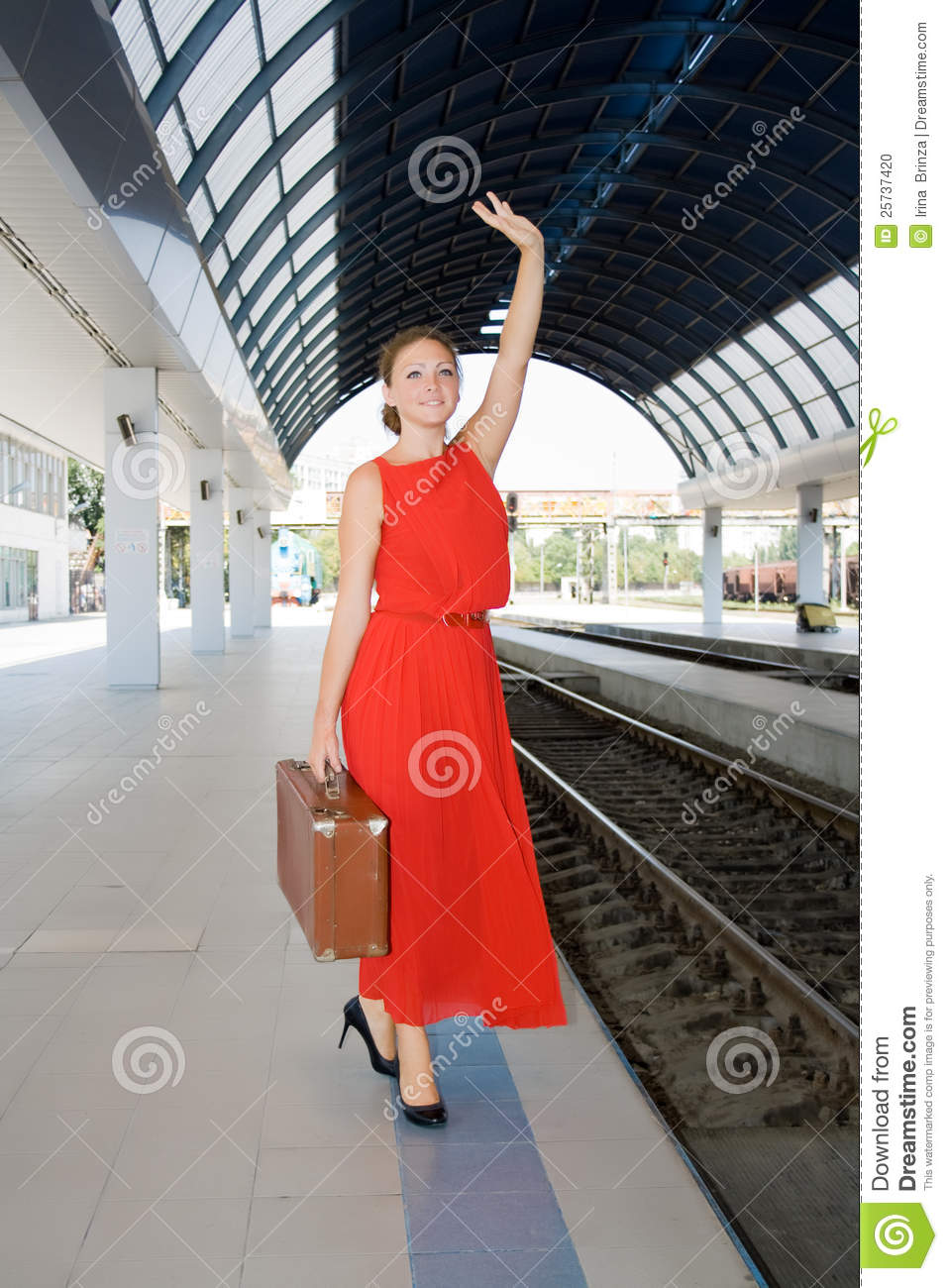 Woman with a suitcase at the railway station