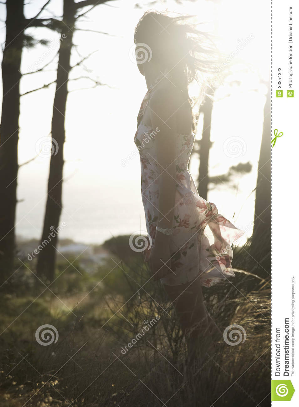 Woman In Summer Dress Enjoying Breeze In Woodland