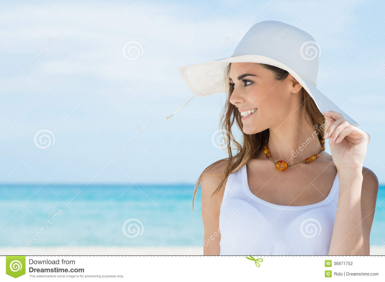 Woman With Sunhat At Beach