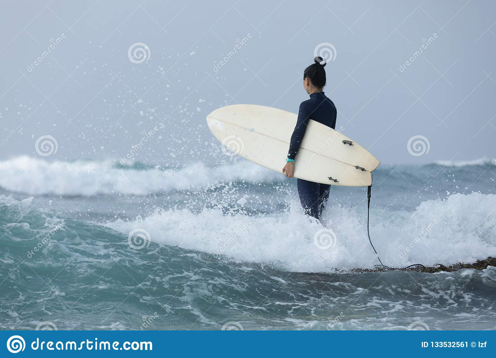 Woman surfer with surfboard