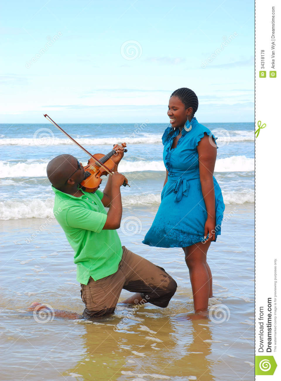 Woman surprised by beach musician