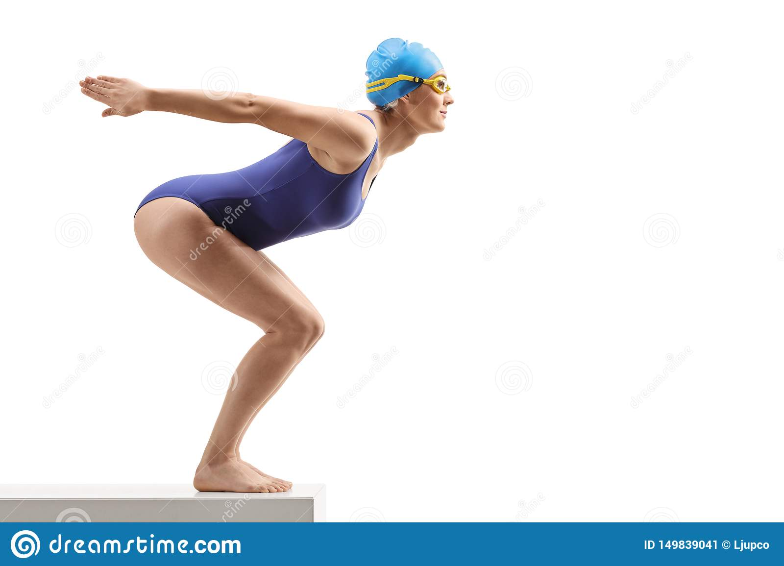 Woman in a swimming suit and cap preparing to jump