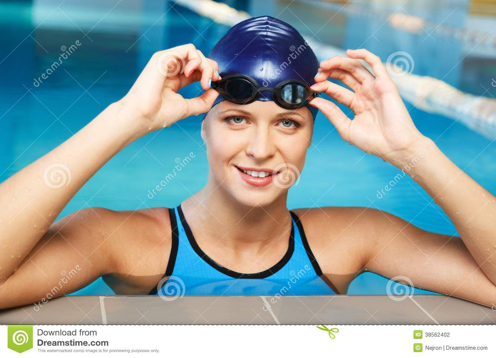 Woman in swimming suit near pool
