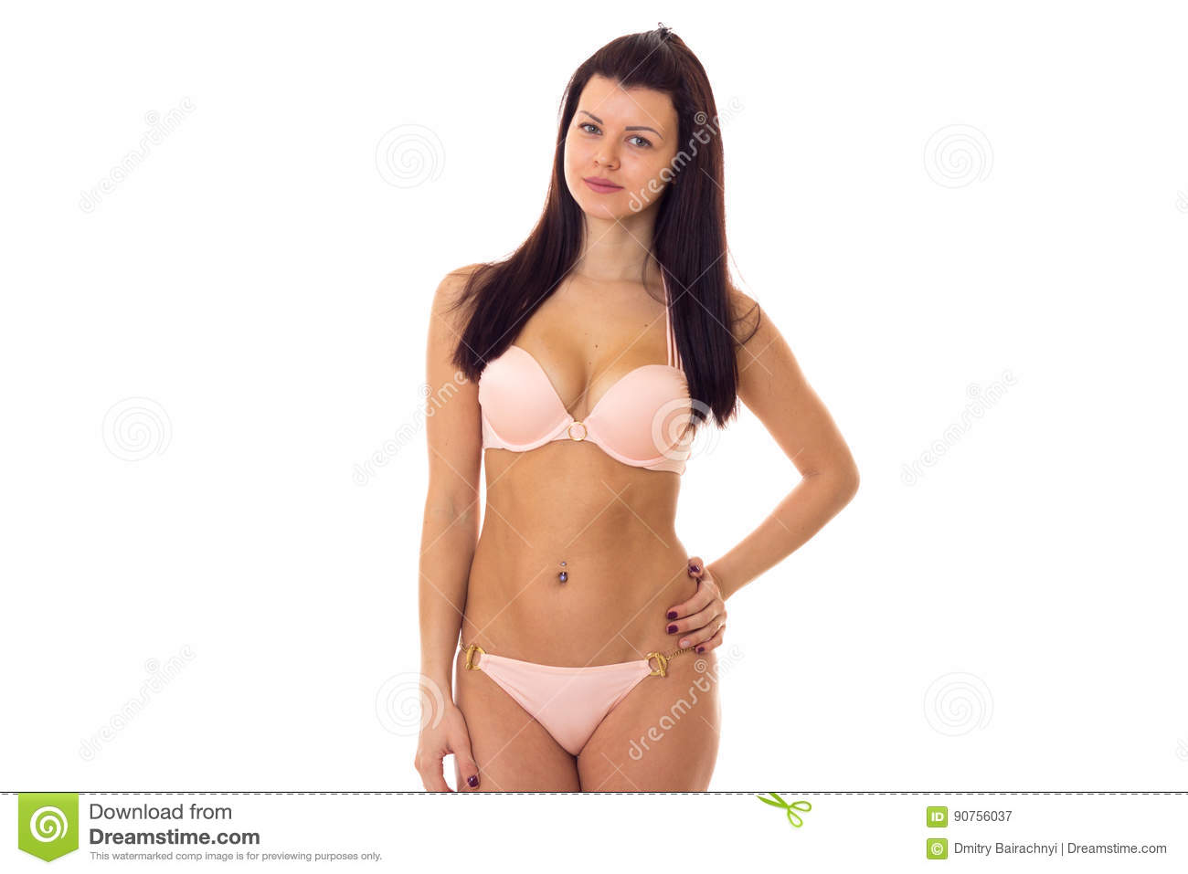 202d3703b1e Young beautiful woman with long black hair in pink swimming suit on white  background in studio