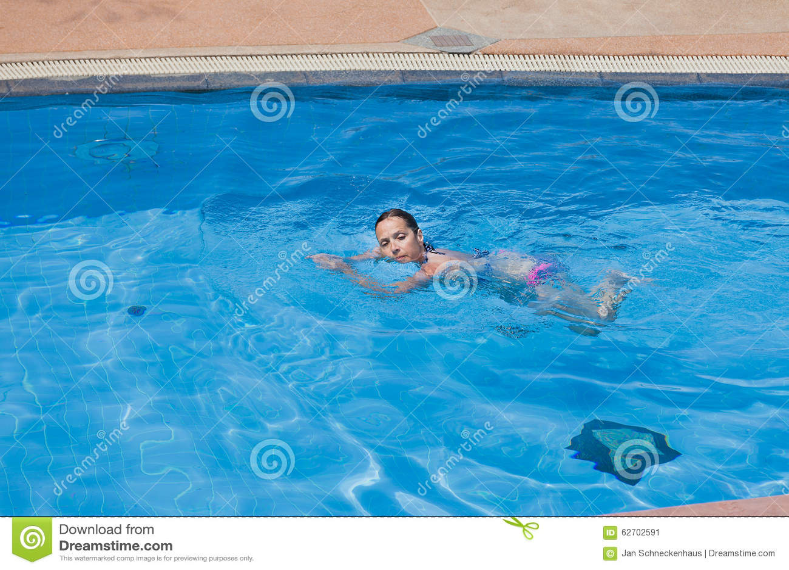 A Woman Swims Alone Stock Photo Image 62702591