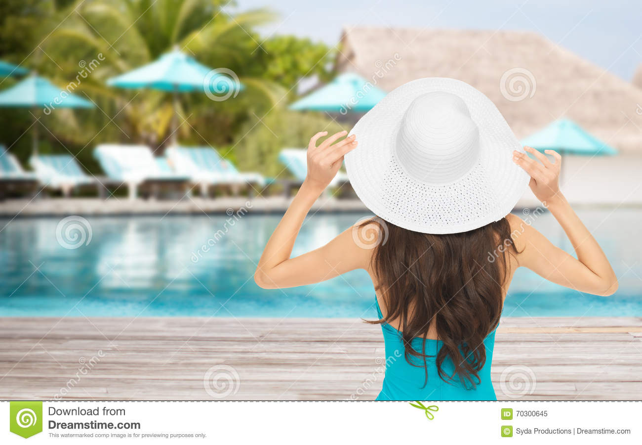 Woman In Swimsuit And Sun Hat From Back Over Beach Stock Image ... a1d2ccda7be