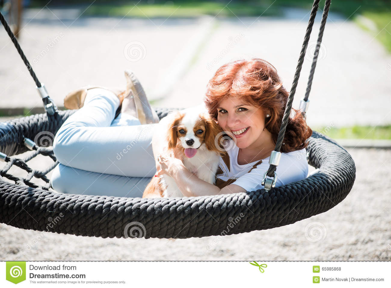 Woman Swing With Her Dog Stock Photo - Image 65985868-7035